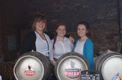 Staff and beer kegs